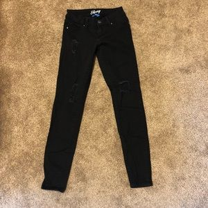 Black skinny YMI jeans with holes. Size 1.